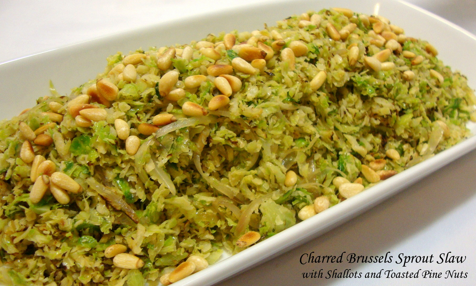 Charred Brussels Sprout Slaw with Shallots and Toasted Pine Nuts